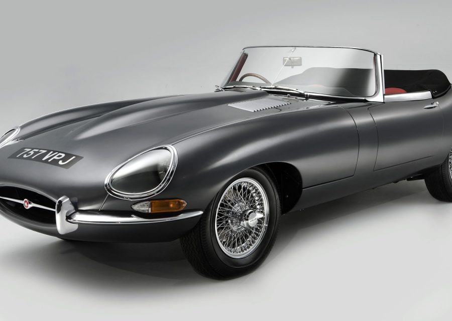 A photo of a black E type jaguar on a white background.