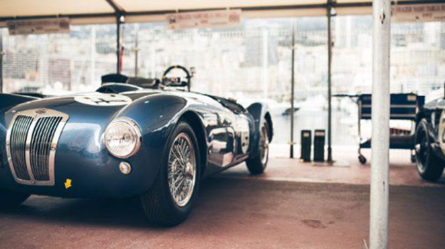 A photo of a blue Classic Bugatti in a garage.