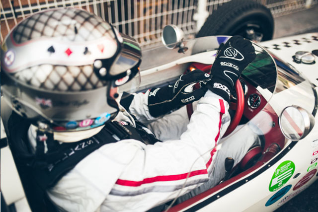A Photo of a classic car racing driver in his cockpit.