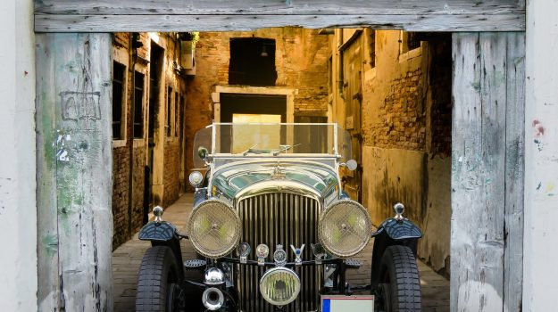 A photo of a classic 1929 yellow Bentley in a garage, similar to one which we have provided classic car finance for.