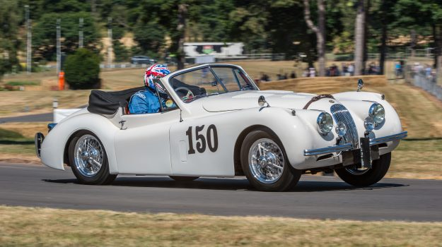 Image of a classic Jaguar XK competing in the hill climb at Chateaux Impney during the launch of Cambridge & Counties Bank's Classic Car Finance division