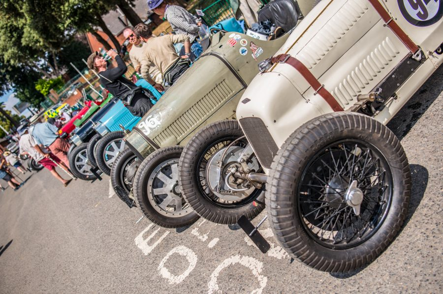 A photo of a series of classic cars in the paddock at the Chateau Impney hill climb event attended by our classic car finance team.