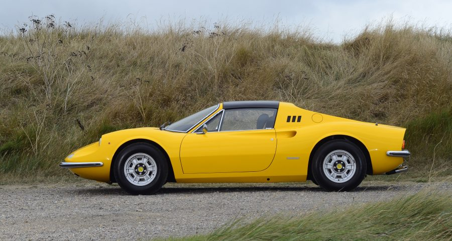 A photo of a yellow classic Ferrari 246 GTS Dino similar to one we have provided classic car finance for.