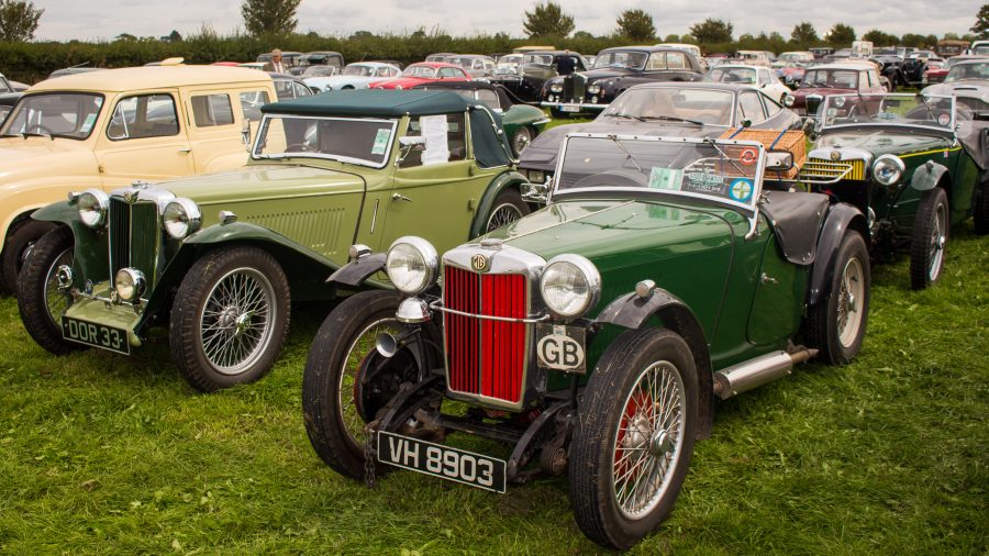 A photo of 2 green Classic MG's at the Goodwood Revival which we attended by our classic car finance team.