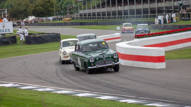A photo of a grey classic Mark 1 Jaguar, racing in the Jack Sears Memorial Race at the Silverstone classic event which was attended by our classic car finance team.