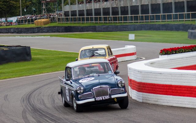 A photo of a blue classic Bentley racing in the Jack Sears Memorial Race at the Silverstone classic event which was attended by our classic car finance team.