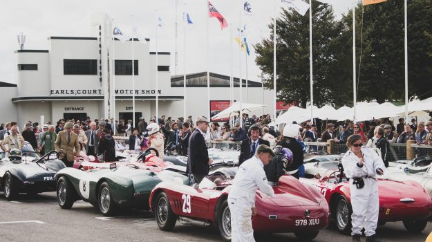 A photo of the Goodwood Revival Sussex Trophy Race Grid with 3 classic race cars in view. The event was attended by our classic car finance team.