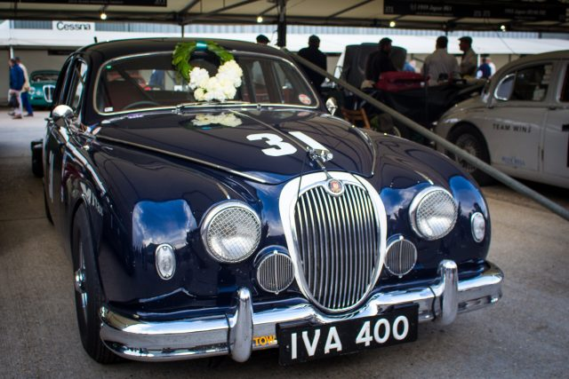 A photo of a blue classic Mark 1 Jaguar in the garage after the Jack Sears Memorial Race at the Silverstone classic event which was attended by our classic car finance team.