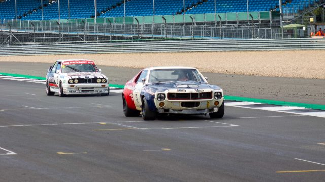 A photo of two Type B Rally cars racing at the Silverstone Classic 2018 which we attended with our Classic Car Finance Team