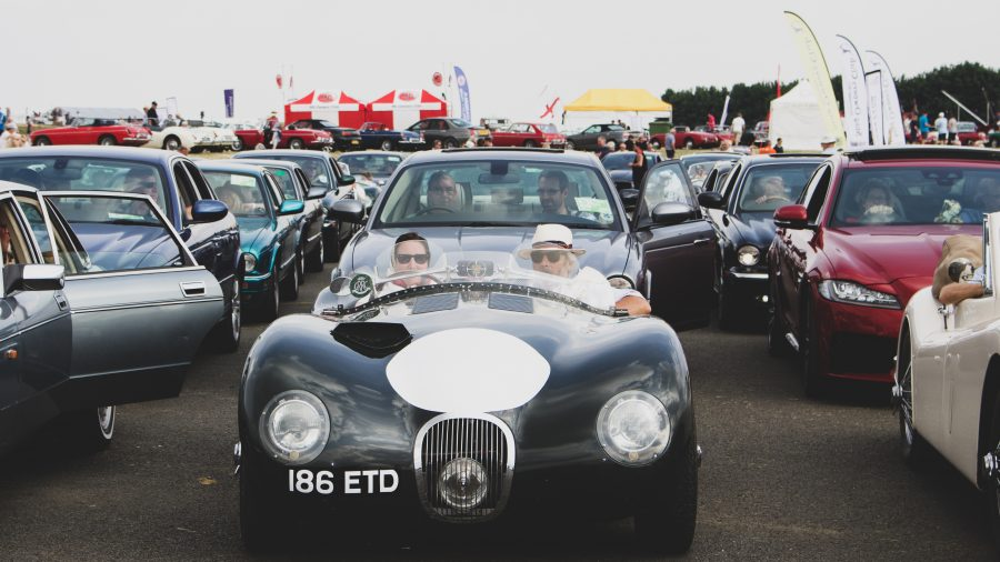 A classic black E Type Jaguar at the Silverstone Classic 2018 .The event was attended by our classic car finance team.