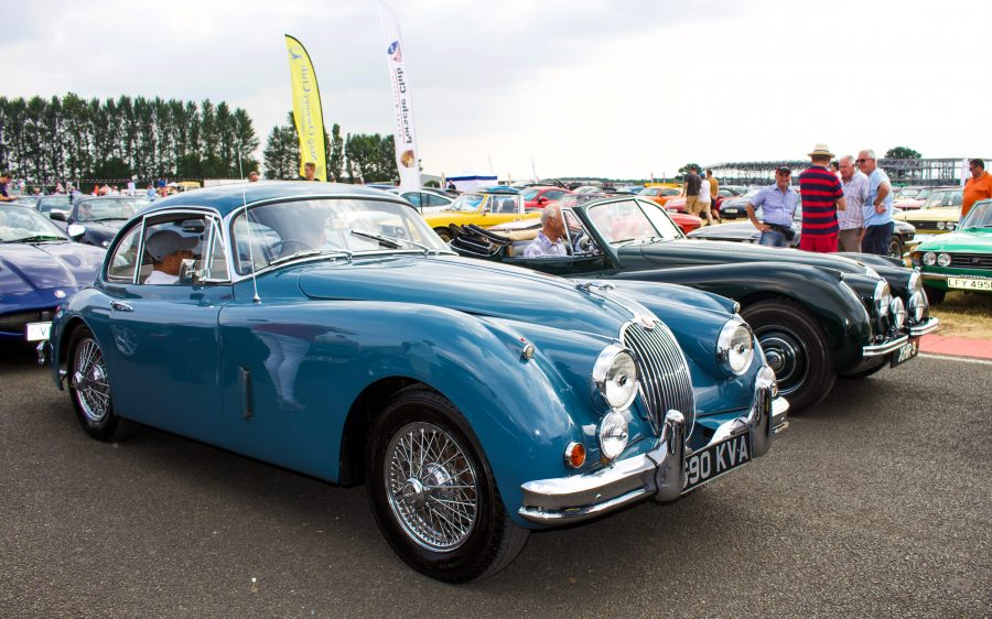 A bright blue classic Jaguar XK120 at the Silverstone Classic 2018 event. The event was attended by our classic car finance team.