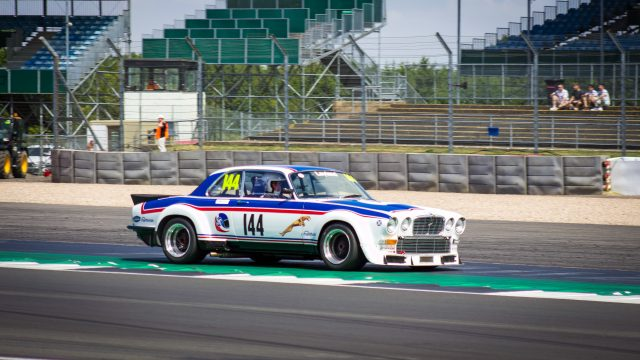 A photo of a Classic Jaguar race car at the Silverstone Classic 2018 event that was attended by our classic car finance team.