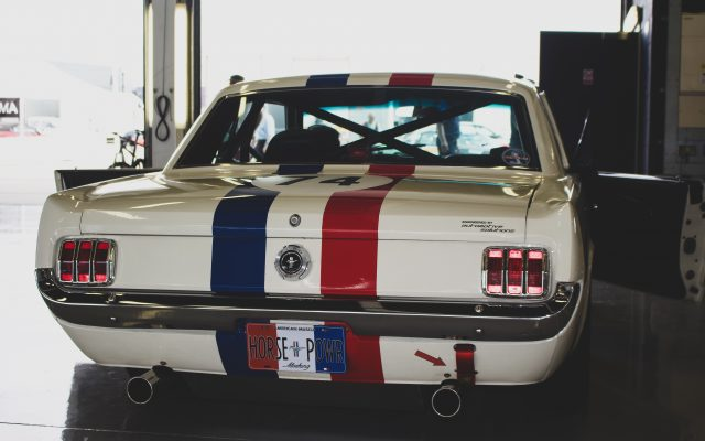 A photo of a Type B Ford Mustang Rally car racing at the Silverstone Classic 2018 event that was attended by our classic car finance team.