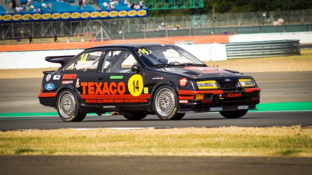 A photo of a Type B Ford Rally car racing at the Silverstone Classic 2018 event that was attended by our classic car finance team.
