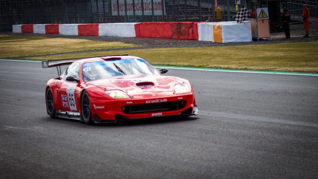 A photo of a Red Ferrari race car at the Silverstone classic 2018 event that was attended by our classic car finance team.