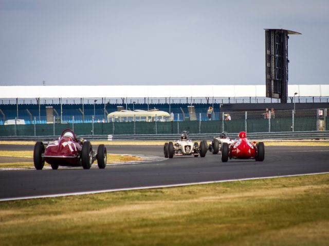 A photo of the Goodwood Revival Sussex Trophy Race Grid with 1 classic race car in view. The event was attended by our classic car finance team.