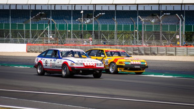A photo of two Type B Rally cars racing at the Silverstone Classic 2018 event. The event was attended by our classic car finance team.