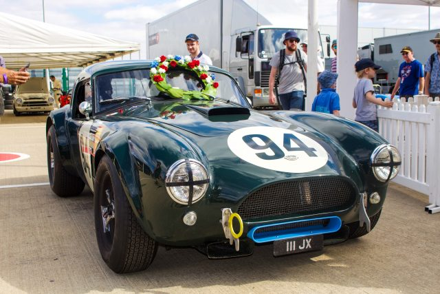 A photo of a green classic Shelby Cobra at the Goodwood Revival 2018 event. The event was attended by our classic car finance team.