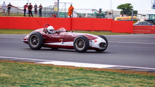A photo of the Goodwood Revival Sussex Trophy Race warm up lap with 1 classic race car in view. The event was attended by our classic car finance team.