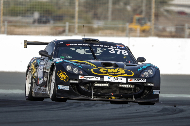 A photo of our sponsored race driver Angus Fender racing his Black & Yellow Ginetta GT5 at the Dubai 24 hour race