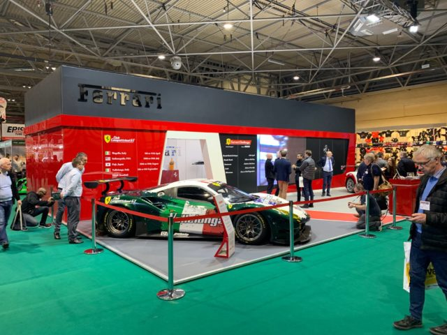 The Ferrari Stand at the Auto Show 2019 with the latest Ferrari race car in the Italian flag colours.